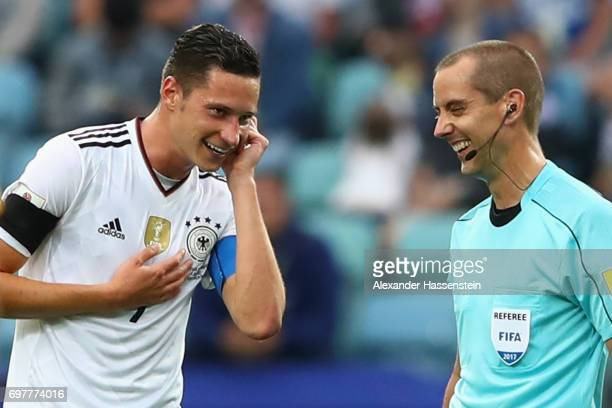 Julian Draxler of Germany jokes with referee Mark Geiger as he communicate with the Video assistent referee during the FIFA Confederations Cup Russia...