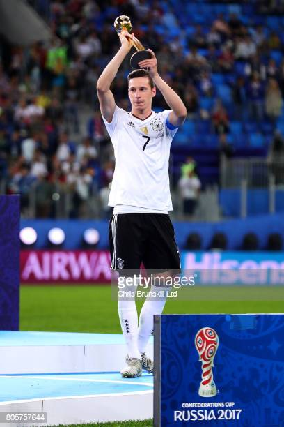 Julian Draxler of Germany lifts the player of the tournament trophy following the FIFA Confederations Cup Russia 2017 Final match between Chile and...