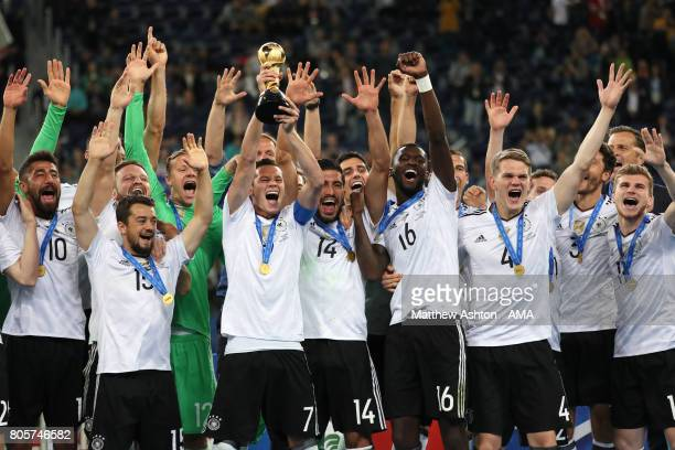 Julian Draxler of Germany lifts the trophy with his teammates at the end of the FIFA Confederations Cup Russia 2017 Final match between Chile and...