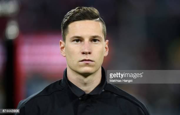 Julian Draxler of Germany looks on during the National Anthems prior to the International friendly match between Germany and France at...