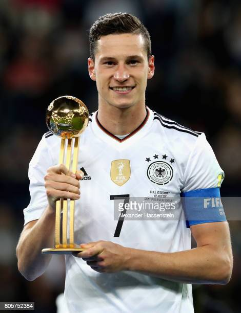 Julian Draxler of Germany poses with the golden ball award after the FIFA Confederations Cup Russia 2017 Final between Chile and Germany at Saint...
