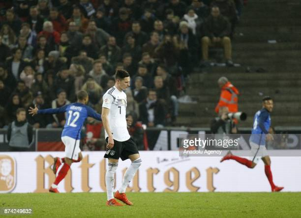 Julian Draxler of Germany reacts after Germany conceded a goal during the international friendly soccer match between Germany and France at...