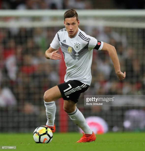 Julian Draxler of Germany runs with the ball during the International friendly match between England and Germany at Wembley Stadium on November 10...