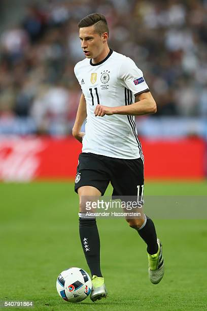 Julian Draxler of Germany runs with the ball during the UEFA EURO 2016 Group C match between Germany and Poland at Stade de France on June 16 2016 in...