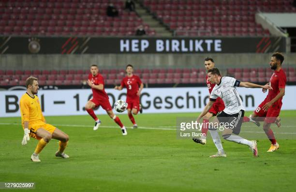 Julian Draxler of Germany scores his team's first goal during the international friendly match between Germany and Turkey at RheinEnergieStadion on...