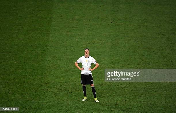 Julian Draxler of Germany shows his dejection after defeat in the UEFA EURO semi final match between Germany and France at Stade Velodrome on July 7...
