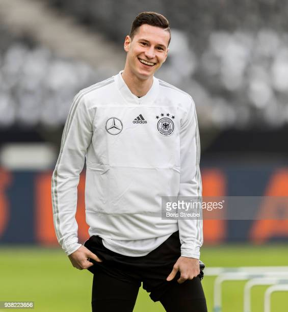 Julian Draxler of Germany smiles during the training session of the German National Team at Olympiastadion on March 26 2018 in Berlin Germany