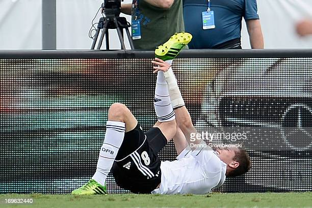 Julian Draxler of Germany suffers an injury during the International Friendly match between Ecuador and Germany at FAU stadium on May 29 2013 in Boca...