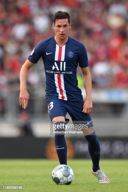 Julian Draxler of Paris plays the ball during the pre-season friendly match between 1. FC Nuernberg and Paris Saint-German at Max-Morlock-Stadion on...
