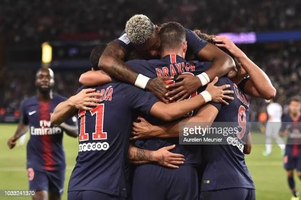 Julian Draxler of Paris Saint-Germain celebrates with teammates after scoring the opening goal during the French Ligue 1 match between Paris Saint...