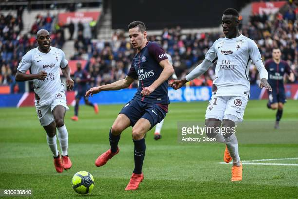 Julian Draxler of PSG and Moussa Niakhate of Metz during the Ligue 1 match between Paris Saint Germain and Metz at Parc des Princes on March 10 2018...