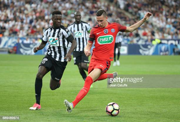 Julian Draxler of PSG and Nicolas Pepe of Angers during the French Cup final between Paris SaintGermain and SCO Angers at Stade de France on May 27...