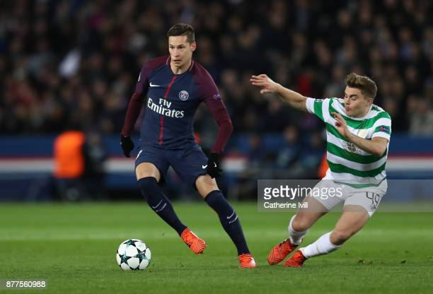 Julian Draxler of PSG goes past James Forrest of Celtic during the UEFA Champions League group B match between Paris SaintGermain and Celtic FC at...