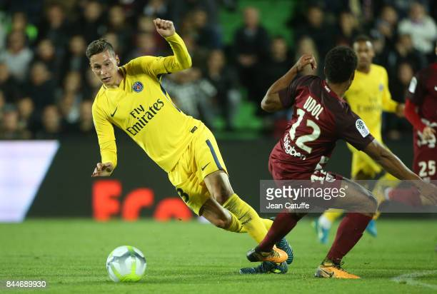 Julian Draxler of PSG Matthieu Udol of FC Metz during the French Ligue 1 match between FC Metz and Paris Saint Germain at Stade SaintSymphorien on...