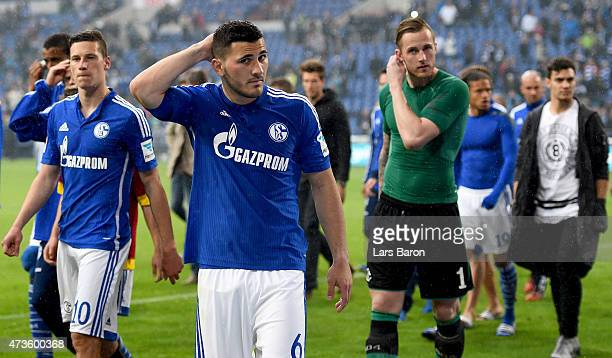 Julian Draxler of Schalke 04 Sead Kolasinac of Schalke 04 and goalkeeper Ralf Fahrmann of Schalke 04 are seen with team mates after the Bundesliga...