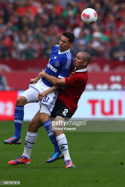 Julian Draxler of Schalke and Leon Andreasen of Hannover go up for a header during the Bundesliga match between Hannover 96 and FC Schalke 04 at AWD...