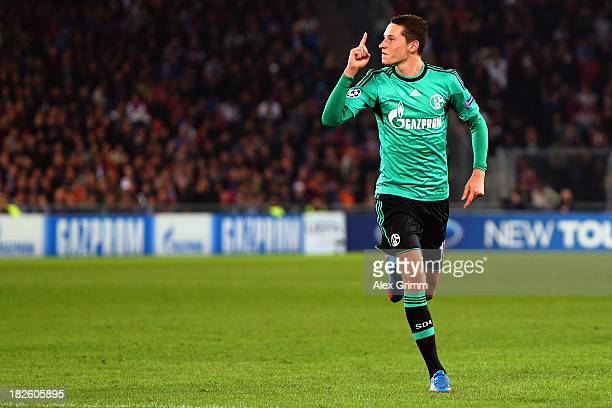 Julian Draxler of Schalke celebrates his team's first goal during the UEFA Champions League Group E match between FC Basel 1893 and FC Schalke 04 at...