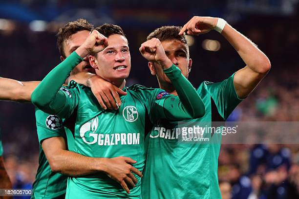Julian Draxler of Schalke celebrates his team's first goal with team mates Marco Hoeger and Roman Neustaedter during the UEFA Champions League Group...