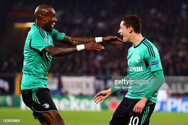 Julian Draxler of Schalke celebrates his team's first goal with team mate Felipe Santana during the UEFA Champions League Group E match between FC...
