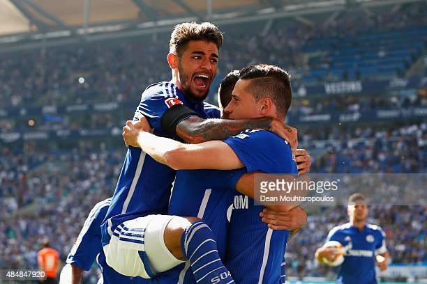 Julian Draxler of Schalke celebrates scoring his teams first goal of the game with Junior Caicara during the Bundesliga match between FC Schalke 04...