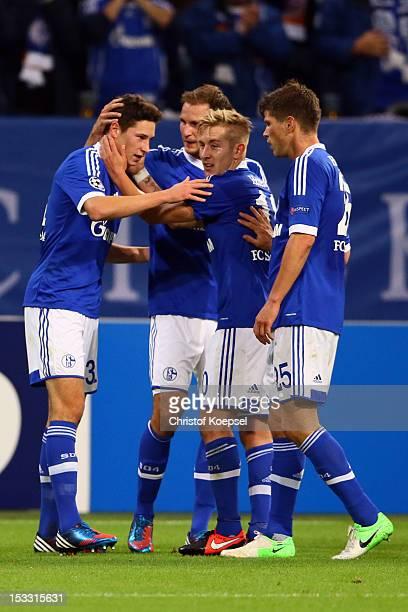 Julian Draxler of Schalke celebrates the first goal with Benedikt Hoewedes Lewis Holtby and KlaasJan Huntelaar during the UEFA Champions League group...