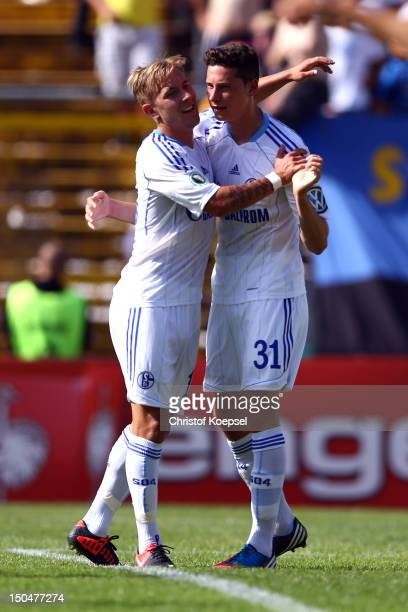 Julian Draxler of Schalke celebrates the second goal with Lewis Holtby of Schalke during the first round DFB Cup match between 1 FC Saarbruecken and...