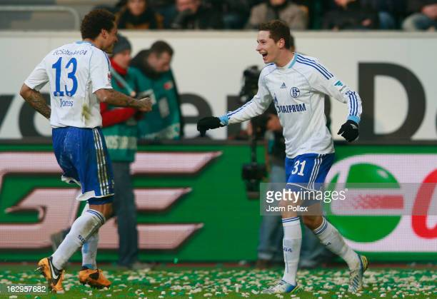 Julian Draxler of Schalke celebrates with his team mate Jermaine Jones after scoring his team's second goal during the Bundesliga match between VfL...