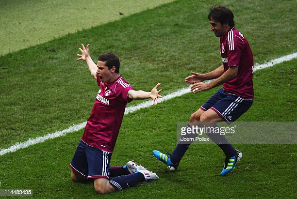 Julian Draxler of Schalke celebrates with his team mate Raul after scoring his team's first goal during the DFB Cup final match between MSV Duisburg...