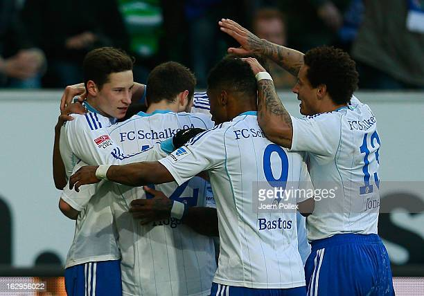 Julian Draxler of Schalke celebrates with his team mates after scoring his team's first goal during the Bundesliga match between VfL Wolfsburg and FC...