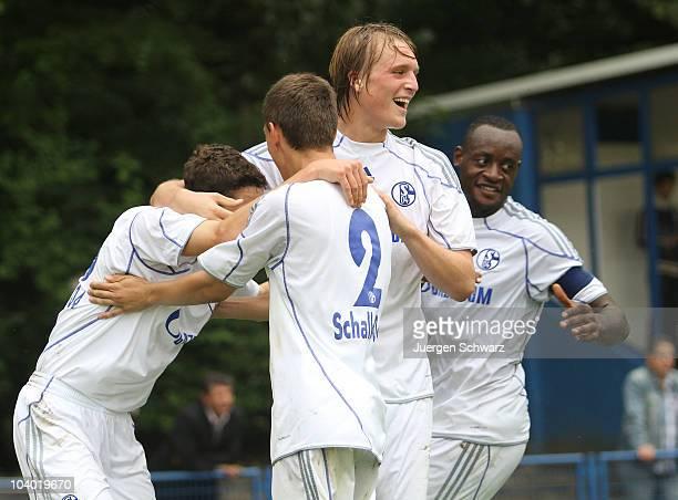 Julian Draxler of Schalke celebrates with team mates after scoring a goal during the AJuniors Bundesliga match between Schalke 04 and Borussia...