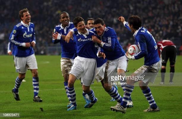 Julian Draxler of Schalke celebrates with team mates after scoring his teams winning goal during the DFB Cup quarter final match between FC Schalke...