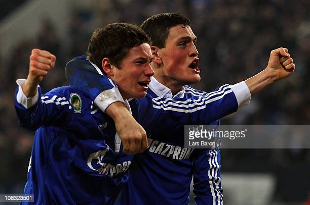 Julian Draxler of Schalke celebrates with team mates after scoring his teams winning goal during the DFB Cup quarter final match between FC Schalke...