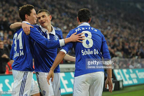 Julian Draxler of Schalke celebrates with teammates after scoring his team's third goal during the Bundesliga match between FC Schalke 04 and VfB...