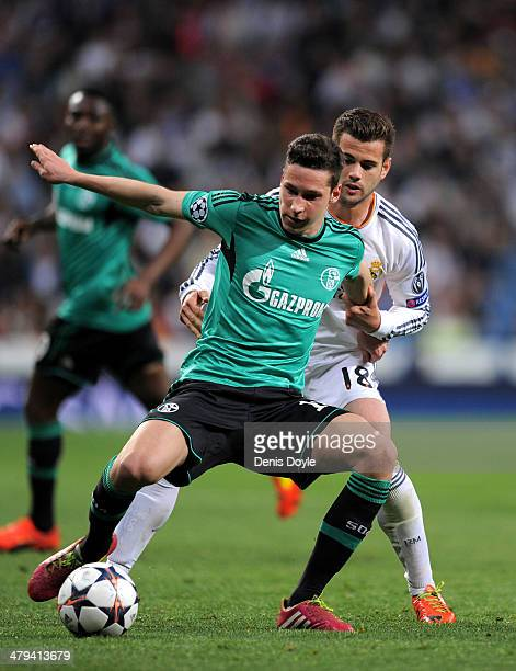 Julian Draxler of Schalke controls the ball under pressure from Nacho Fernandez of Real Madrid during the UEFA Champions League Round of 16 second...
