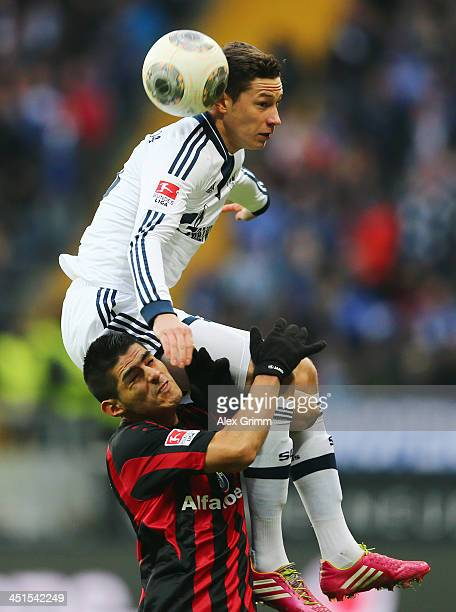 Julian Draxler of Schalke is challenged by Carlos Zambrano of Frankfurt during the Bundesliga match between Eintracht Frankfurt and FC Schalke 04 at...
