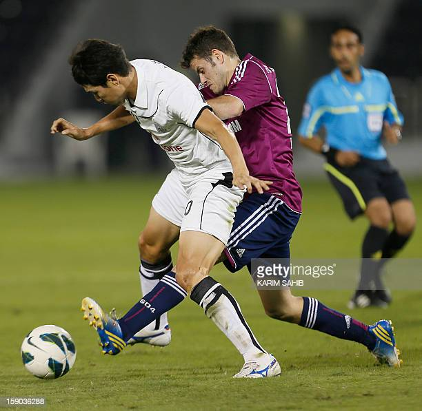 Julian Draxler of Schalke is challenged by Jung Soo Lee of Qatar's alSadd during their friendly football match in Doha on January 6 2013 Schalke is...