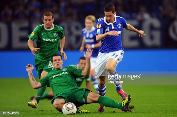 Julian Draxler of Schalke is challenged by Jurica Buljat of Haifa during the UEFA Europa League group J match between FC Schalke 04 and Maccabi Haifa...