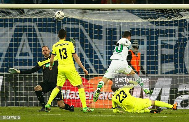 Julian Draxler of Wolfsburg scores his team's second goal during the UEFA Champions League round of 16 first leg match between KAA Gent and VfL...