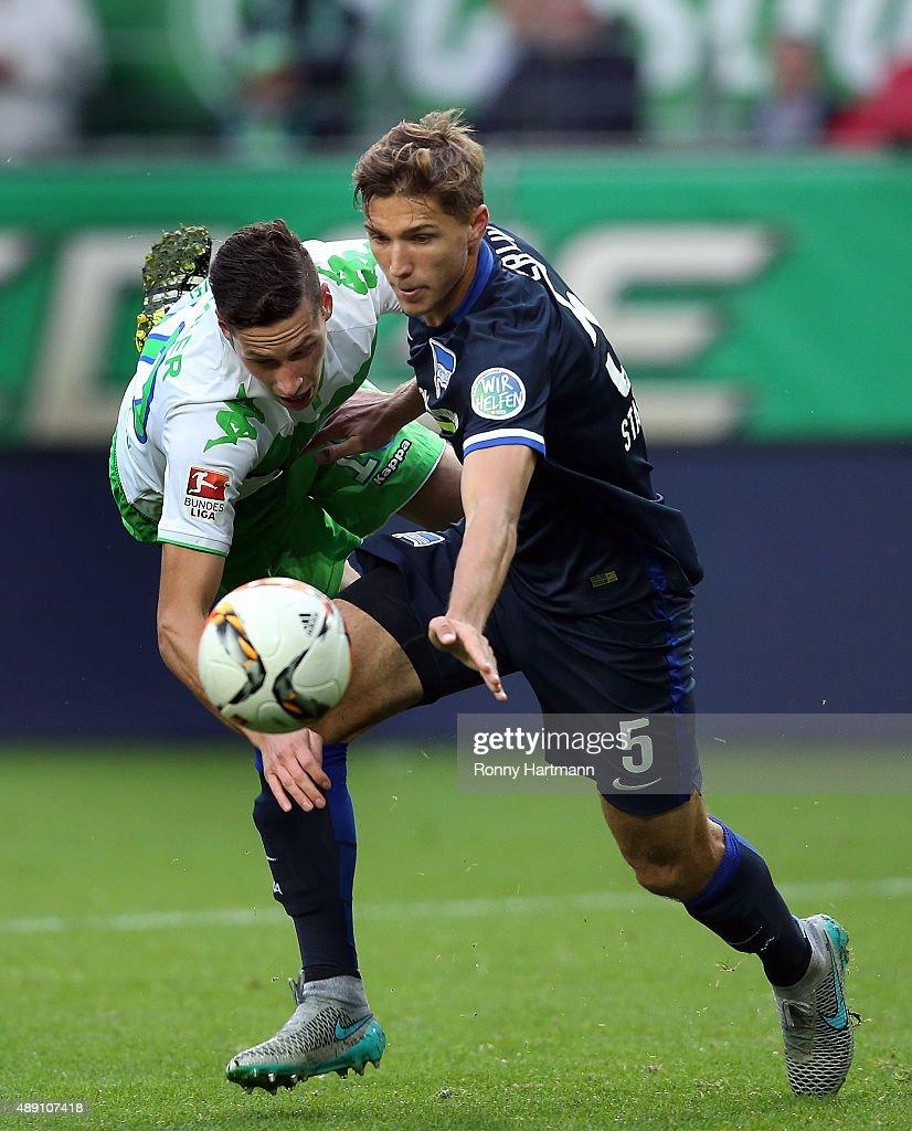 Julian Draxler (L) of Wolfsburg vies with Niklas Stark of Berlin during the Bundesliga match between VfL Wolfsburg and Hertha BSC at Volkswagen Arena on September 19, 2015 in Wolfsburg, Germany.