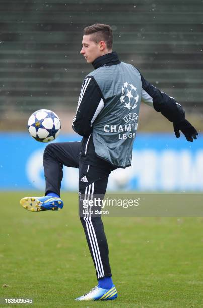 Julian Draxler plays with the ball during a FC Schalke 04 training session ahead of their UEFA Champions League round of 16 match against Galatasaray...