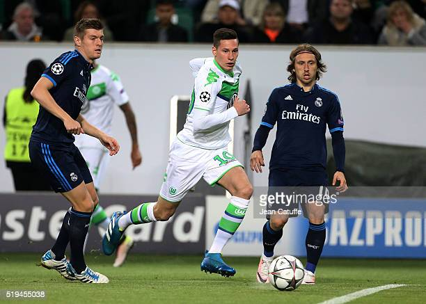 Julian Drexler of Wolfsburg in action between Toni Kroos and Luka Modric of Real Madrid during the UEFA Champions League quarter final first leg...
