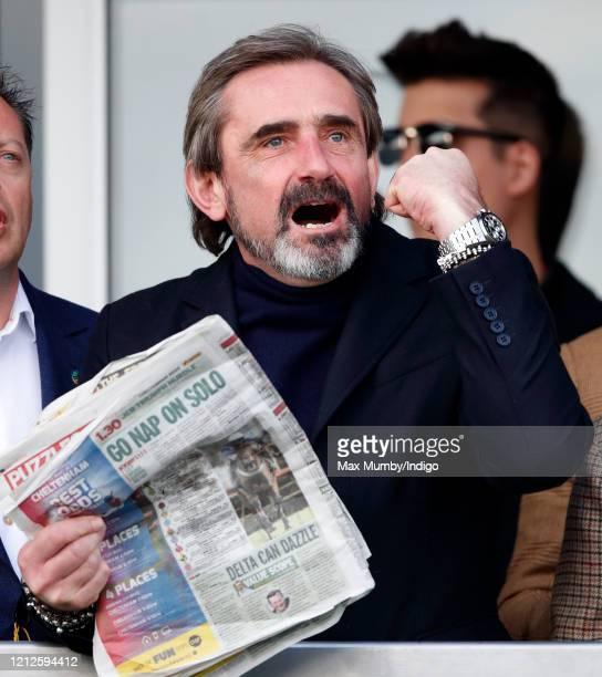 Julian Dunkerton cheers whilst watching the racing on day 4 'Gold Cup Day' of the Cheltenham Festival 2020 at Cheltenham Racecourse on March 13 2020...