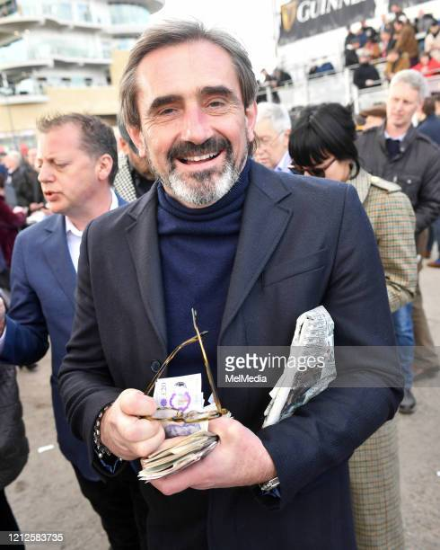 Julian Dunkerton seen collecting his winnings as he attends Day 4 of the Cheltenham Festival 2020 at Cheltenham Racecourse on March 13 2020 in...