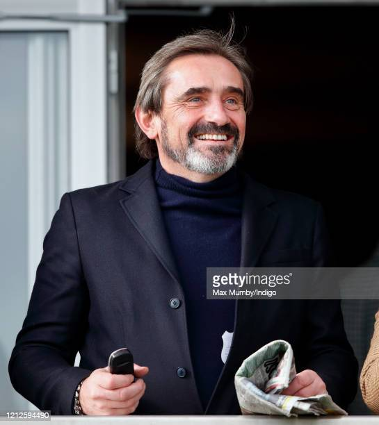 Julian Dunkerton watches the racing on day 4 'Gold Cup Day' of the Cheltenham Festival 2020 at Cheltenham Racecourse on March 13 2020 in Cheltenham...