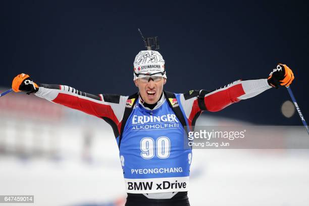 Julian Eberhard of Austria celebrates winning the Men 10km Sprint during the BMW IBU World Cup Biathlon 2017 test event for PyeongChang 2018 Winter...