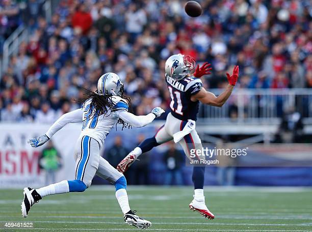 Julian Edelman of the New as Rashean Mathis of the Detroit Lions defends during the first quarter at Gillette Stadium on November 23, 2014 in...