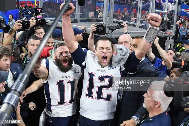 Julian Edelman of the New England Patriots and teammate Tom Brady celebrate at the end of the Super Bowl LIII at MercedesBenz Stadium on February 3...