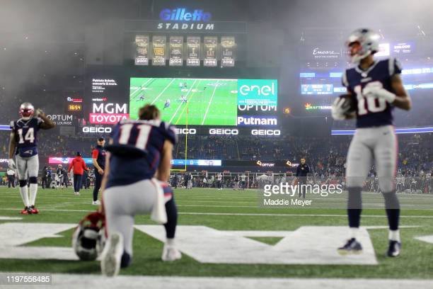 Julian Edelman of the New England Patriots and teammates watch the Buffalo Bills v Houston Texans game on the Jumbotron before taking on the...