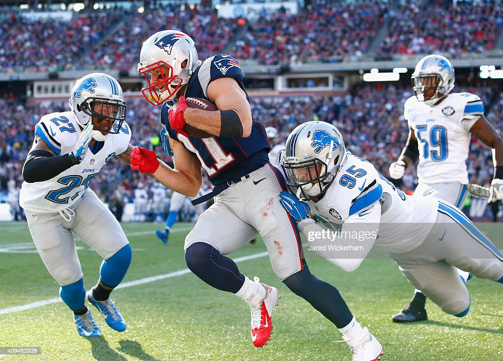 Julian Edelman #11 of the New England Patriots carries the ball after a catch during the second quarter against the Detroit Lions at Gillette Stadium on November 23, 2014 in Foxboro, Massachusetts.