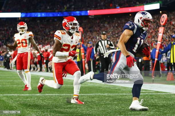 Julian Edelman of the New England Patriots catches a pass for a touchdown in the second quarter of a game against the Kansas City Chiefs at Gillette...
